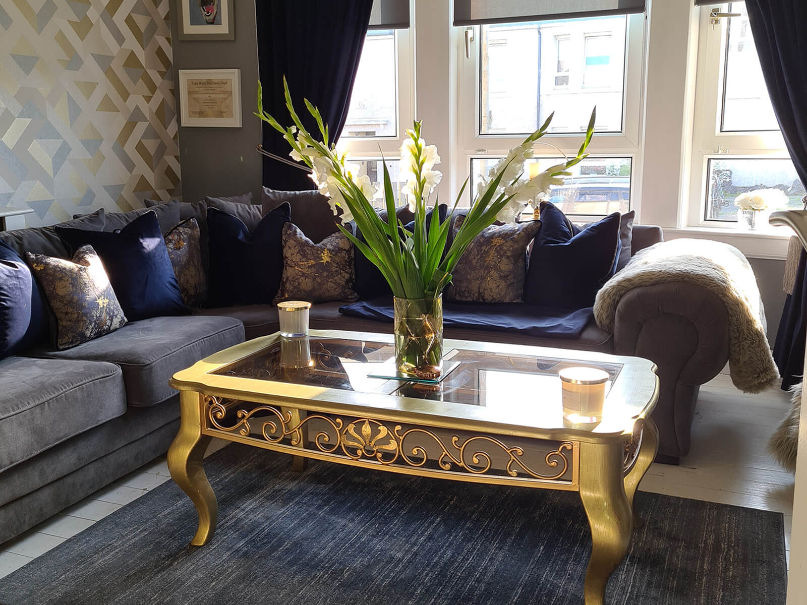 Luxurious living room incorporating brown sofa, gold coffee table and soft furnishings